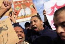 Egyptian pro-Mubarak supporters shout slogans during a march in Cairo, Egypt, 1 February 2011